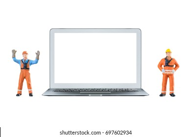 Smart laptop computer with white blank screen and miniature engineering people stand beside the laptop computerElegant Design for mock up industry and construction concept.