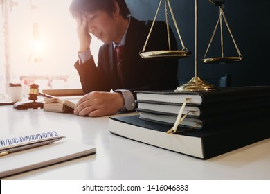 smart lawyer feeling tired and stressed in the office before considering the judgment, lawyer concept