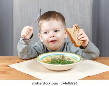 Smart little boy has dinner