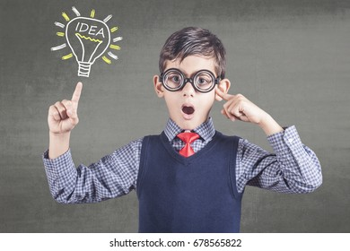 Smart little boy having an idea. Education, innovation and creativity concept