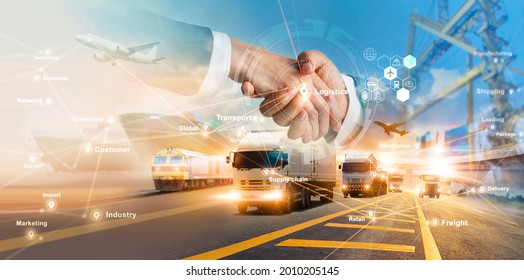 Smart logistics and transportation. Handshake for successful of investment deal teamwork and partnership business partners on logistic global network distribution. Business of transport industrial.  - Shutterstock ID 2010205145