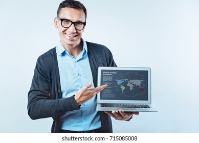Smart man showing laptop with global trading transfers