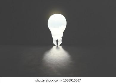 smart man walking through bulb shape door, creative concept