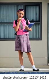Smart Minority Girl Student Wearing School Uniform Standing