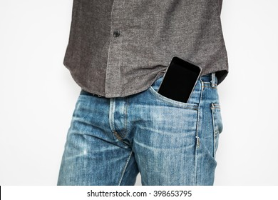 Smart mobile phone in jeans pocket