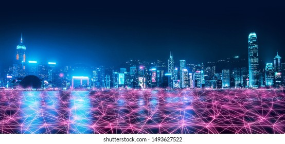 Smart network and Connection technology concept, Hong Kong digital city background at night in victoria harbour, Cyberpunk color style, Panorama view
