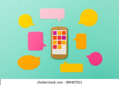 Smart phone with app icons and colorful speechbubbles - mobile communication concept for social networks, messaging apps or multimedia marketing