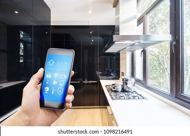 smart phone with apps in modern kitchen