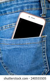 Smart phone in back pocket of girl's jeans .