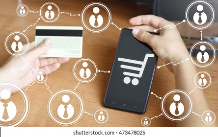 Smart phone cart online internet pay buy shop credit card network cyber web shopping, mobile purchase. Bank card, gift card, trolley, telephone. Shopping via phone, payment by credit card, network.