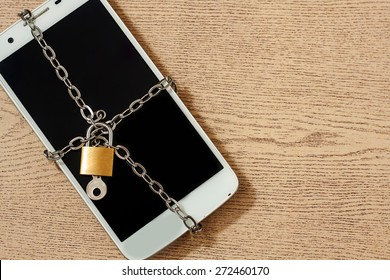 smart phone with chain lock ,black and white color tone. abstract background for solution to security smart phone form not owner.