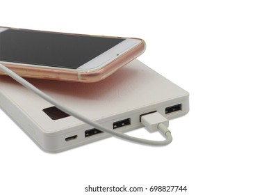 Smart phone charging with power bank on white
