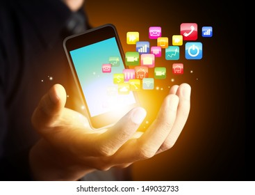Smart phone with cloud of application icons in consumer hand