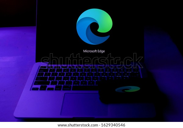 Smart phone and computer with the new Microsoft Edge logo based on Chromium, which will be the default browser in the next versions of Windows 10. United States, New York, Tuesday, November 5, 2020.