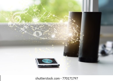 Smart phone connecting to bluetooth speaker with music lines and notes, smart life concept