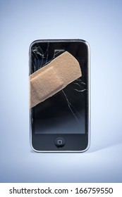 Smart Phone with cracked screen, fixed with sticking plaster.