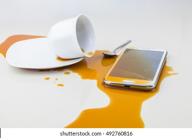 Smart phone dropped coffee spilled on white background