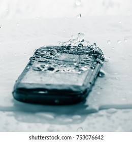 Smart phone fail broken on tile floor with water spilled Selected Focus Toned