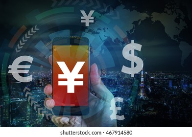 smart phone and financial technology (FinTech), japanese yen, chinese yuan, key currency symbols, worldwide trading, abstract image visual