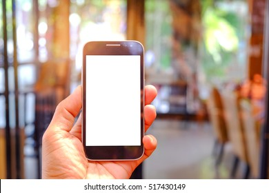 Smart phone in hand with glass blurred background.