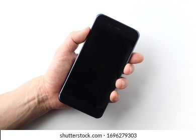 smart phone held in a male hand on white background