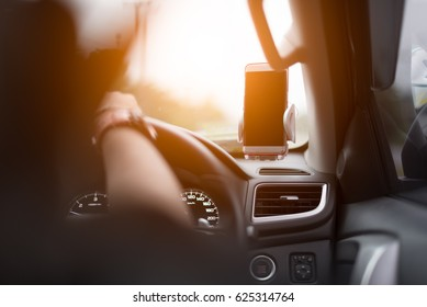 Smart phone with smart phone holder in car.
