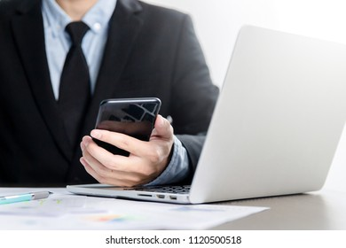 smart phone holding in businessman hands. Blurred background. Horizontal mockup