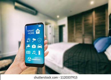 Smart phone with smart home app in bedroom