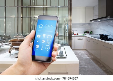 smart phone with smart home and modern kitchen