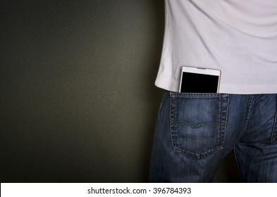 Smart phone in jeans pocket