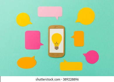 Smart phone with light bulb symbol and talk bubbles - concept for e-learning, online classes, mobile marketing, apps and communication with space for text
