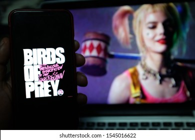 Smart phone with a logo of Birds of Prey which is a Harley Quinn movie comics character next to be released in 2020. United States, California. Tuesday, October 29, 2019