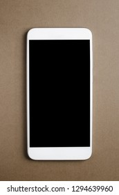 Smart phone or Mobile phone on paper background, from above