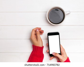 Smart phone mock-up. Woman's hands in red sweater holding smartphone with blank white screen.