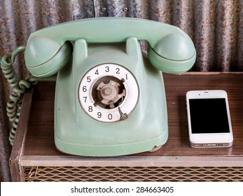 Smart phone and old telephone