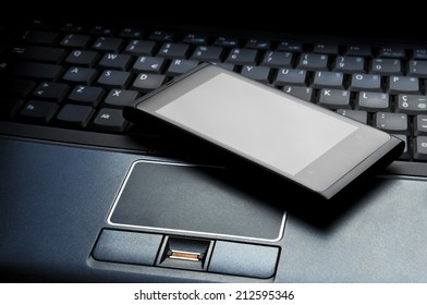 A smart phone on a laptop to indicate an equipment for the business