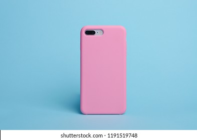 Smart phone on a light blue background in a pink plastic case back view. Template of phone case. Iphone 8+ case mock up