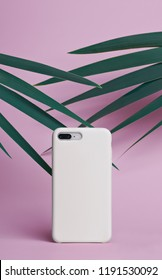 Smart phone on a pink background of palm leaves in a white plastic case back view. Template of iphone case