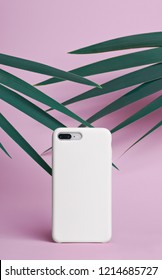 Smart phone on a pink background of palm leaves in a white plastic case back view. Mock up of phone case for iPhone 8 plus