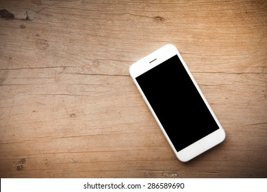 Smart phone on wooden background