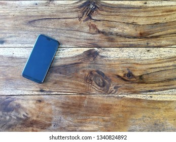 Smart phone on a wooden table,Summer ideas.