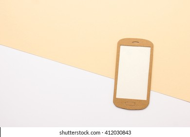 Smart phone paper model with empty screen on view leading background - space for text