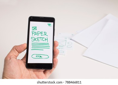 Smart phone with paper sketch mock up, prototype test for mobile application, user experience design