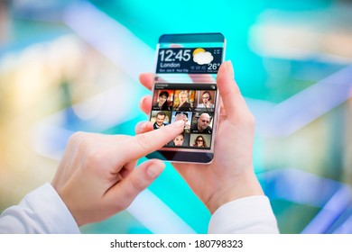 Smart phone (phablet) with a transparent display in human hands. Concept actual future innovative ideas and best technologies humanity.