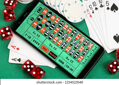 smart phone with roulette table, online gambling concept
