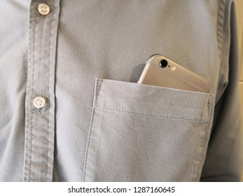 Smart phone in shirt pocket of a asian business man, Technology Smartphone background concept