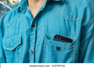 Smart phone in shirt pocket of a business man