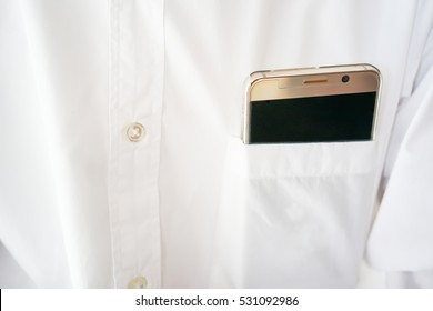 Smart phone in shirt pocket of a business man, Technology smartphone background concept