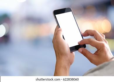 Smart phone showing blank screen in man hand at walk street,night light bokeh Background