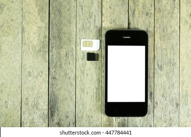 smart phone and sim card, micro sd card on wood background